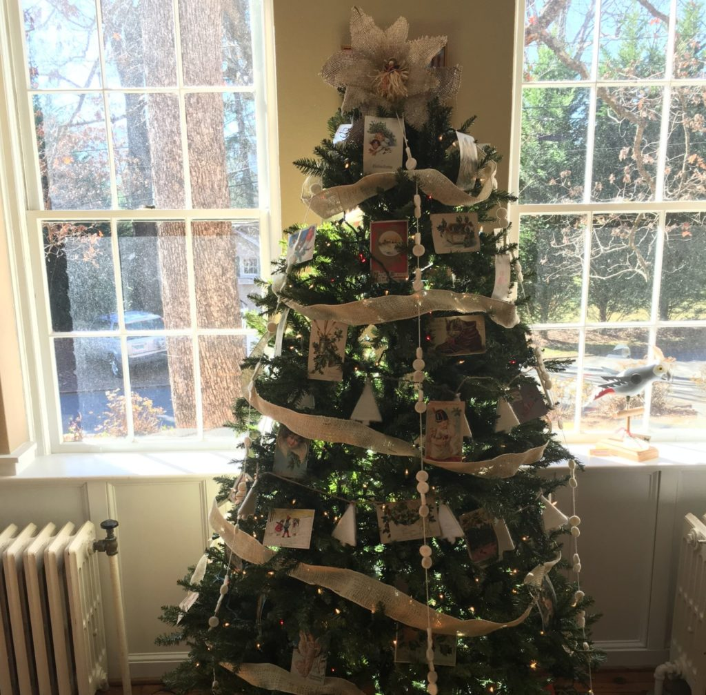 Decorated christmas tree with vintage postcards